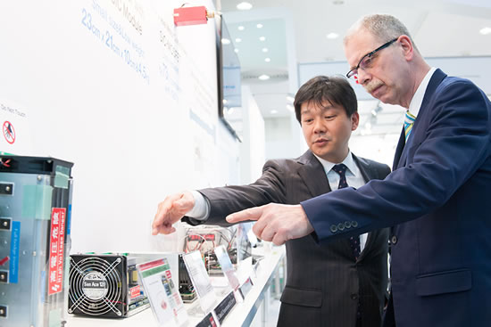 Fig. 2 General Manager Ino introducing the latest SiC power device technology